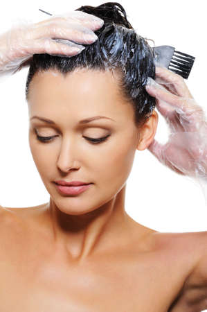 hair conditioner: Portrait of pretty beautiful young woman dyeing  hairs Stock Photo