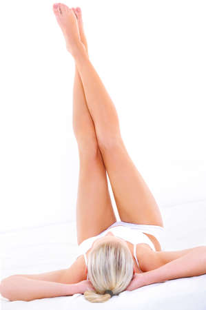 Beautiful slim long womans legs over white background photo