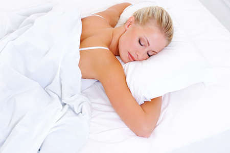 cushion: Blonde beautiful woman sleeping in the bed - high-angle shoot Stock Photo