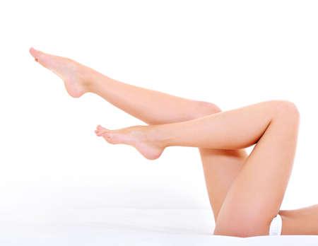 woman lying down: Beautiful long  woman legs over white background