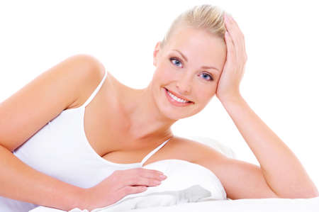 toothy: Portrait of beautiful  cheerful woman with happy toothy smile lying down on the white  bed