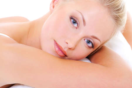 Close-up face of a beautiful blond woman with blue eyes and health clear skin photo