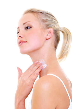 woman face cream: Beautiful woman applying moisturizer cream on her neck - isolated on white