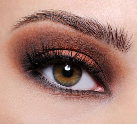 eyeshadows: Front view of a close-up female eye with brown eyeshadow make-up Stock Photo