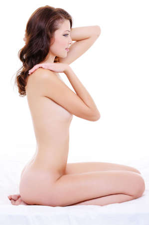 Profile portrait of young caucasian female with a nude body over white photo