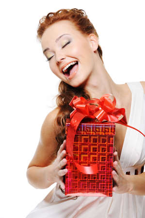 Happiness of a beautiful woman holding the red box  and looking up over white background photo