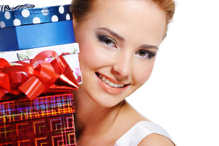 Close-up face of a pretty smiling girl with the many presents over white background Stock Photo - 5694197
