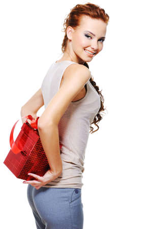 Happy young woman cover up behind back the red christmas present box Stock Photo - 5694222