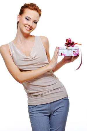 Beautiful cheerful youn woman holding the small present box over white background Stock Photo