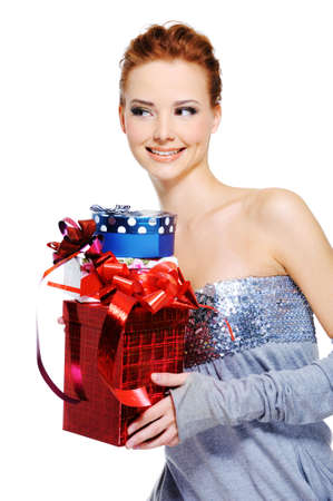 Cute fun femlae holding the christmas present boxes - isolated on white photo