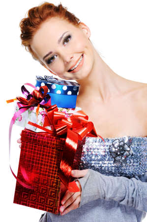 Portrait of a smiling beautiful girl with gift boxes in hands Stock Photo