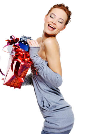 beautiful happy laughing  woman holding the christmas boxes  over white background photo