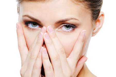 Young female cover by hands her clean face photo