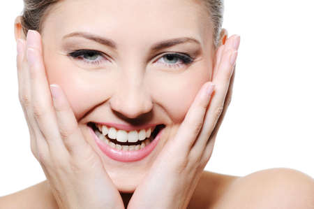 Beauty happy female with the hands at her clean  face over white backgroun