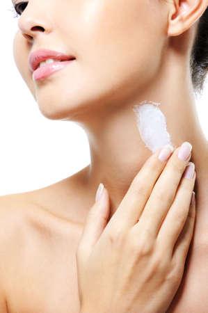 beautiful neck: Unrecognizable female person apply cosmetic cream on her neck Stock Photo