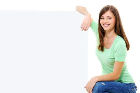 Young happy female person with an white billboard - isolated on white Stock Photo - 5769484