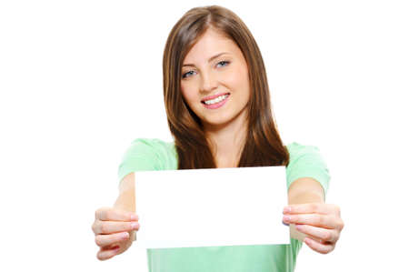 Portrait of a Happy young beautiful female holding blank card - over white background photo