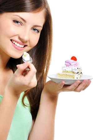 Beauty hübsche junge Frau mit dem Kuchen auf dem Teller over white