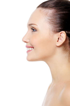 side profiles: Profile portrait of smiling womans face with clean pure skin over white background