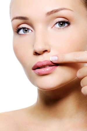 finger on lips: Close-up face of a beauty female with finger near her lips Stock Photo