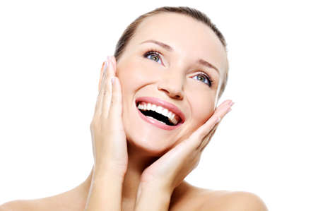 Beauty happy laughing female face with a healthy white teeth photo