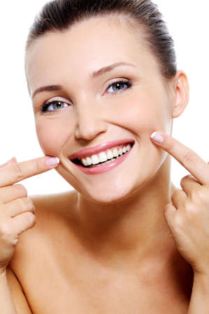 smiling teeth: Beauty smiling fresh woman  face with the health teeth Stock Photo