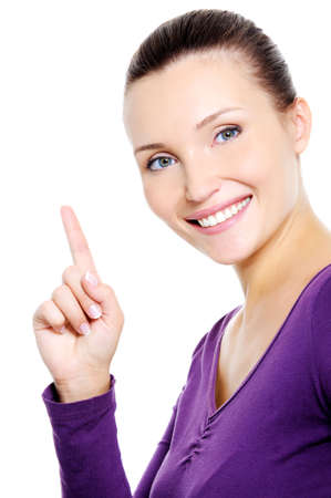 Portrait of young happys miling woman showing index finger - isolated photo