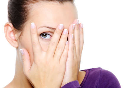 emotive: Portrait of young woman hide her face and watch through fingers