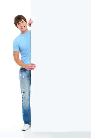 Full-length portrait of a smiling young handsome man with blank banner Stock Photo - 5830681