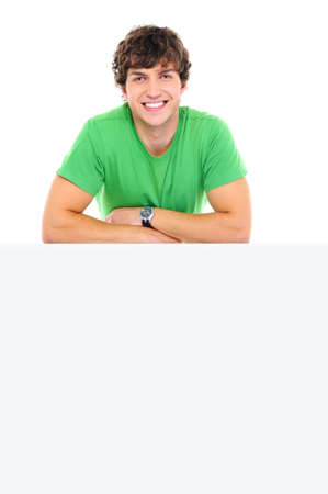 Happy man lean on the white banner - over white background Stock Photo - 5830683