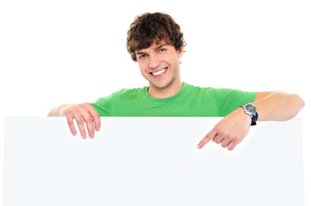 Close-up portrait of happy man under blank banner and showing on it by finger Stock Photo - 5830689