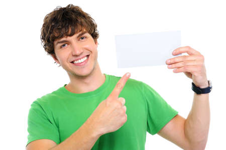 notecard: Handsome happy man showing on by finger on blank card