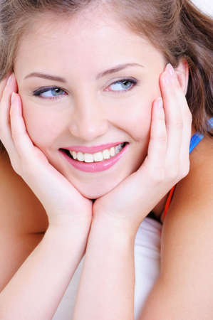 Portrait of a cheerful young female with the white helth smile photo