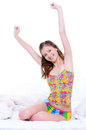 wakeup: Beautiful female stretch oneself after wake-up - over white background