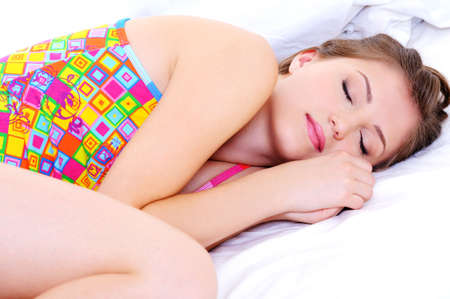 Beautiful young female in multicolored underwear sleeping snuggle Stock Photo - 5830706