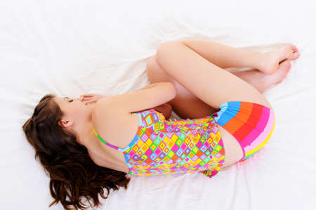 High angle portrait of young woman sleeping snuggle in bed photo