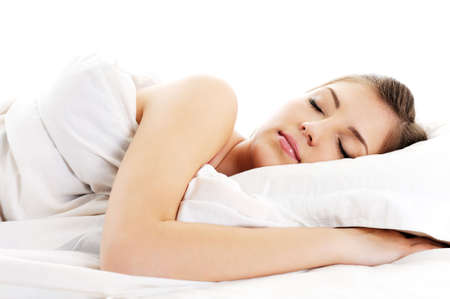 Front view portrait of beautiful resting woman cover white blanket  photo