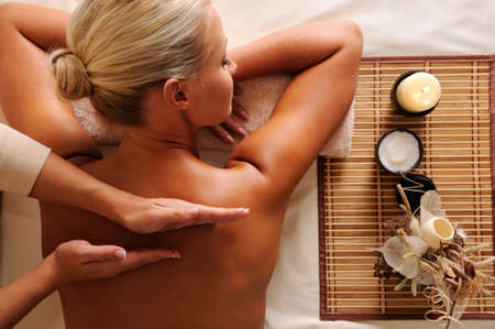 massage: Woman getting  recreation massage in spa salon - high angle