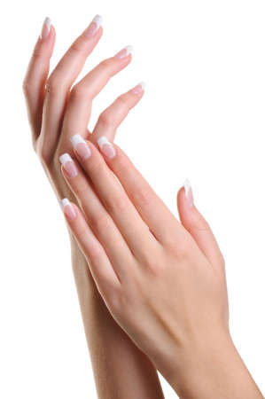 manicure: Beauty elegant female hands with french manicure isolated on white
