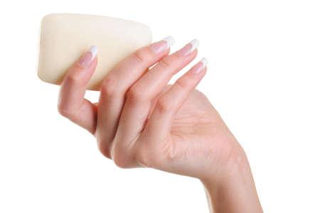 higienizar: Beautiful and elegant human female hand with white soap - over white background