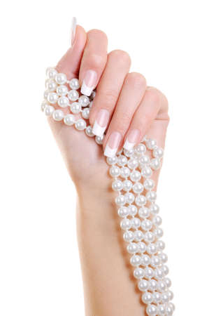 perl: Beautiful elegant woman hand with french manicure hold the white  perl over white background