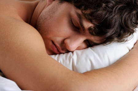 sweet dreams: Close-up face of a sleeping young handsome male