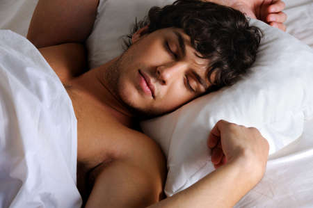 pillow sleep: Portrait of a sweet sleeping young beautiful   man lying on back Stock Photo