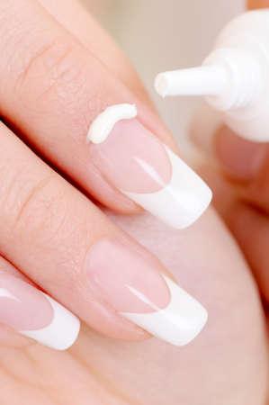 macro shot of a female index finger with  moisturizing cream on it  photo