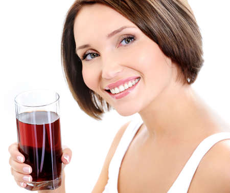 Young beautiful woman holding glass of fresh pomegranate juice photo