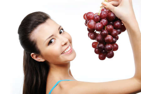 close-up portrait of young beautiful happy woman with bunch of grapes Stock Photo - 5878886