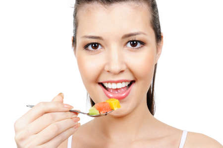 citrous: cheerful young female face with spoon with pieces of fruits
