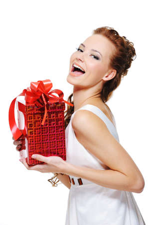 Cute laughing girl holding the red box present over white background Stock Photo