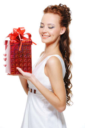 joy of giving: Pretty female holding in hands the red box with the  christmas present in it