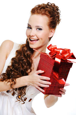 Portrait of a look out beautiful happy female with red box in  hands photo